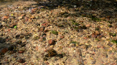 small pebble stones closeup underwater of flowing river stream Footage