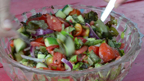 salad tomatoes cucumber onion lettuce leaves mix glass dish Footage