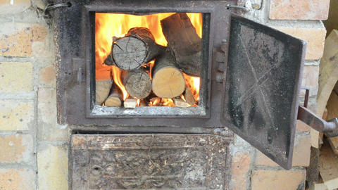 Firewood Wood Burn In Retro Old Rusty Rural Kitchen Stove stock footage