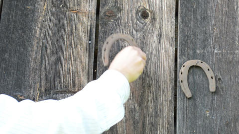 retro rusty horse shoe hand hanging old wooden rural house wall Footage