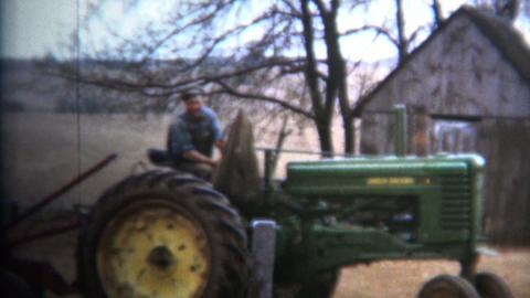 (8mm Vintage) 1952 Proud Iowa Farmer on Tractor Footage