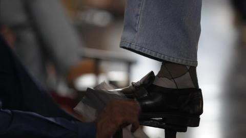 shoe polish at railway station Live Action