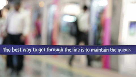 Instructions For Commuters To Obey The Queue.Mumbai Metro Train At Station stock footage