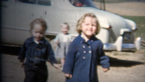 (8mm Vintage) 1952 Kids Playing Baby Blue Classic Car. Iowa, USA Footage