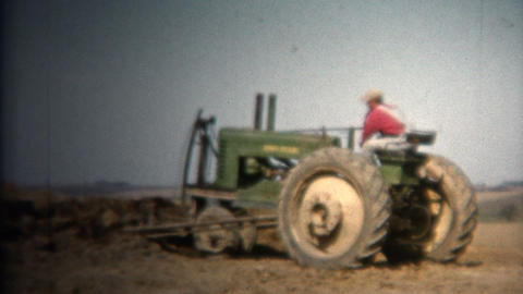 (8mm Vintage) 1952 Farmer Moving Topsoil John Deere Tractor. Iowa, USA Footage