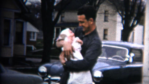 (8mm Vintage) 1952 Dad Holds Baby Car & House Background. Iowa, USA Footage