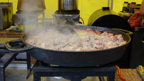 meat cook pan fire and vapour rise outdoor restaurant Footage