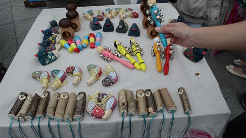 handmade wooden natural toy sale outdoor fair market hand take Footage