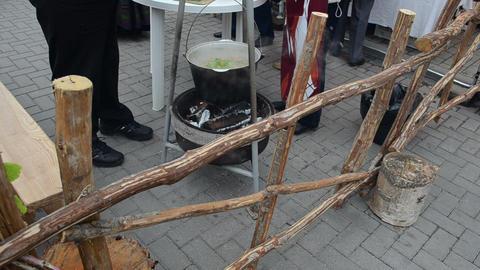 cook natural pilaf meal steel pot fire outdoor autumn fair Footage