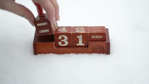 hand change date retro wooden calendar winter snow new... Stock Video Footage