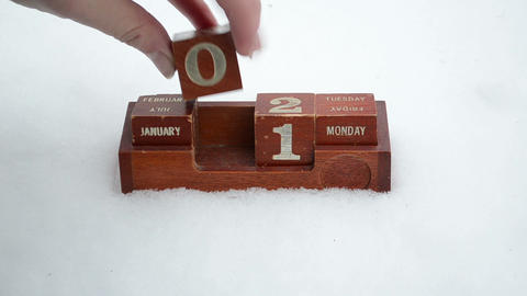 hand change date retro wooden calendar winter snow new 2013 year Footage