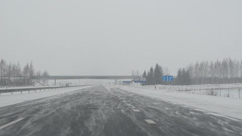 drive highway. snow fall dense snowstorm. car front window view Footage