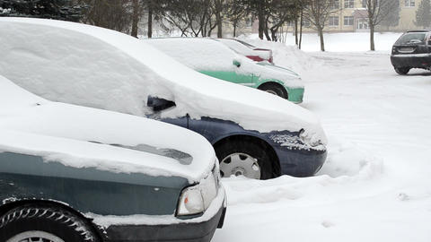 cars standing outdoor parking blizzard snow falling winter Footage