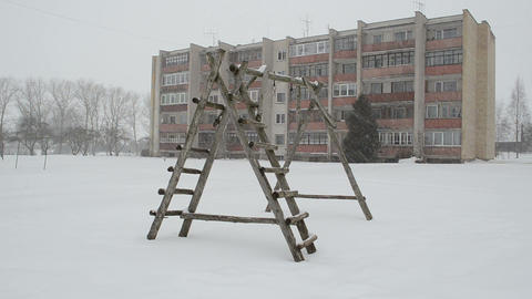 old wooden child playground winter blizzard snowstorm snow fall Footage