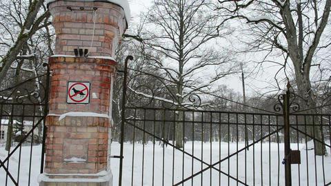 locked retro steel park gates winter people walk snow Footage