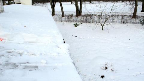 closeup worker shovel push snow roof. hard winter works Footage