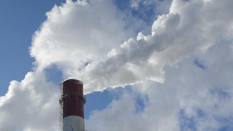 industrial chimney fume heating boiler house city blue sky Footage