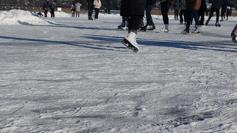 people legs skate slide on frozen lake ice in cold winter day Footage