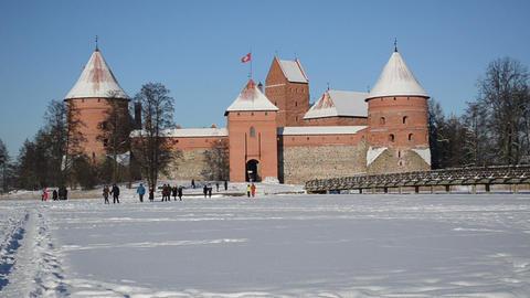 Trakai castle fortification frozen Galves lake winter people Footage