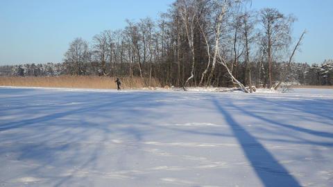 active man skier recreate sport refresh trip frozen lake island Footage