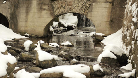 brook water flow run stone retro architecture arch snow winter Footage