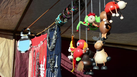 handmade toys jewelry necklaces sold outdoor spring fair market Footage