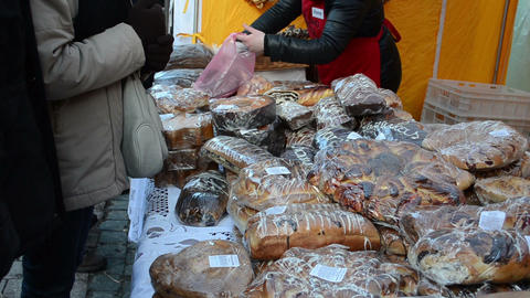 people buy flour products sugary cakes bread outdoor market fair Footage