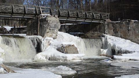 river waterfall retro bridge frozen ice icicles winter Footage