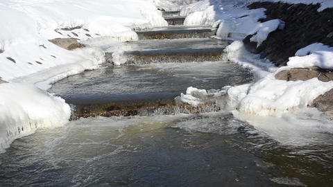 river stairs icy snowy banks cascade waterfall beauty winter day Footage