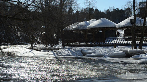 summer houses cottage covered snow rapid frozen river winter Footage