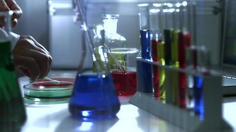 Laboratory CSI 190 investigating dolly stylized Stock Video Footage