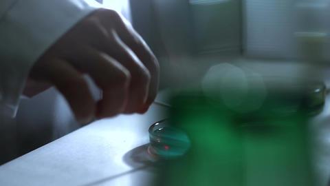 Laboratory CSI 192 investigating dolly stylized Stock Video Footage