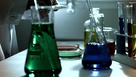 Laboratory CSI 238 investigating dolly stylized Stock Video Footage