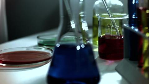 Laboratory CSI 242 investigating dolly stylized Stock Video Footage