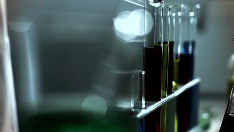 Laboratory CSI 246 investigating dolly stylized Stock Video Footage