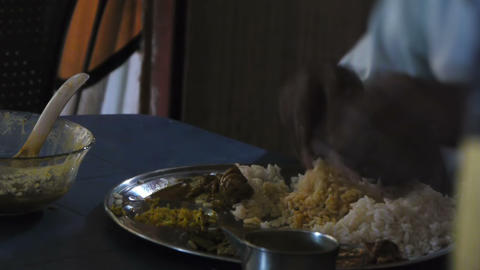 Indian man eats with hands Stock Video Footage
