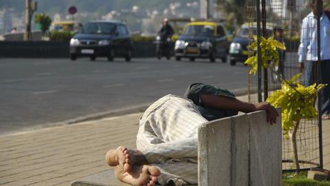 Man sleeping on a street bench Stock Video Footage