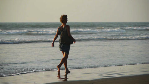 Woman with a dog walks at a beach Stock Video Footage