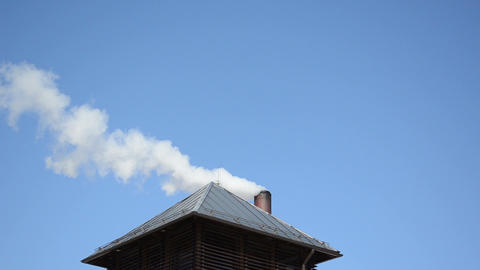 white smoke fume rise house roof chimney background blue sky Footage