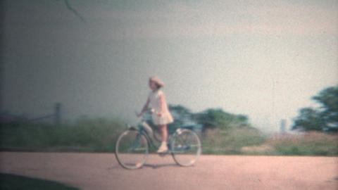(8mm Vintage) 1962 Girl Riding Bike Around the Family Farm. Iowa, USA Footage