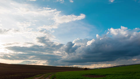 Dramatic Sky over the Endless Fields. Time Lapse 4K Footage
