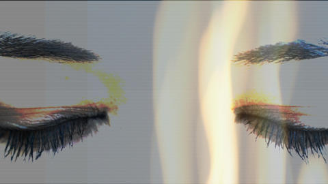 Female eyes against fire Animation