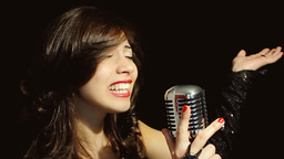 Music woman singer vowels GIF