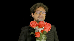 Old man offering red roses Footage