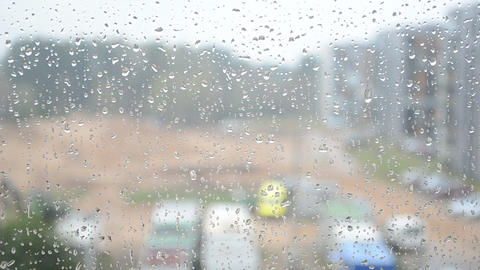 rain water drops on glass and blurred outdoor view Footage
