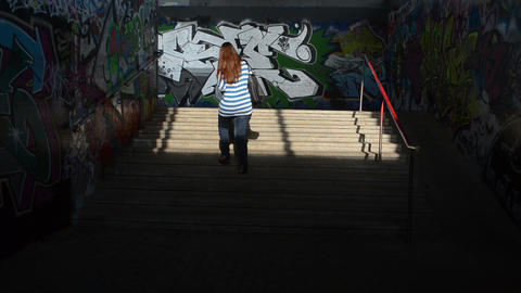 girl walk upstairs from city underground dark passage subway Footage