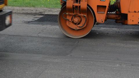 Car pass heavy vibration roller machine asphalt press works Footage