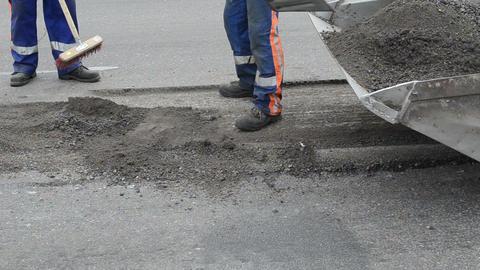 Worker uniform shovel load asphalt remains to small rv bobcat Footage