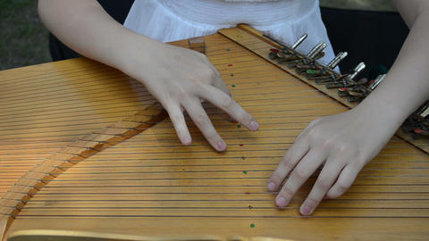 girl hands play Baltic psaltery string musical instrument Live Action