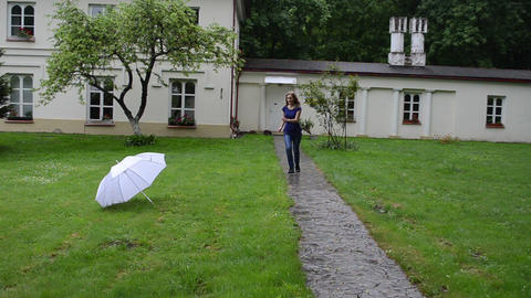 Woman take big white umbrella and spin it with smile on face Footage